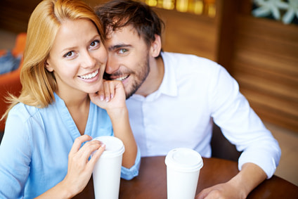 Woman applied the respect principle, sitting with her man sitting in a cafe drinking coffee