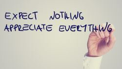 Hand writing Expect Nothing, Appreciate Everything - Expectations cannot be implemented in critcism